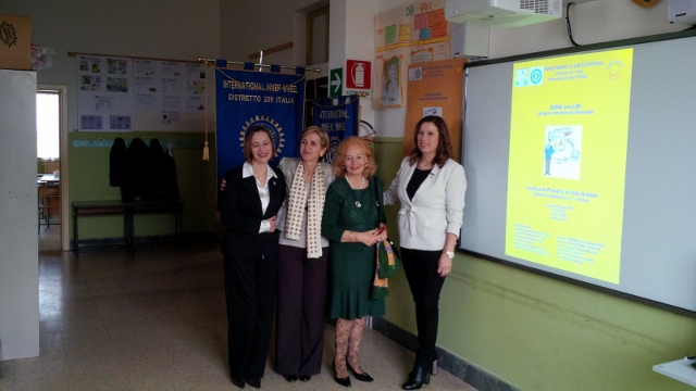 From left to right Club member Nicolina Di Sario, D209 Chairman Daniela Soderi, NR Ebe Martines, Club President Laura D'Auria Mascitti